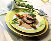 Braised goat leg on white wine sauce with choice vegetables