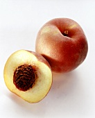 One whole and one halved peach