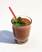 Chocolate Shake with Mint Leaves and a Red Straw