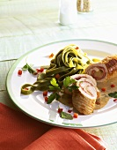 Turkey roulade filled with cheese & ham, green ribbon pasta