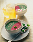 Two soups in one bowl: beetroot and watercress