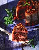 Chocolate cherry gateau, with a piece on cake slice