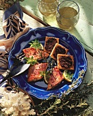 Fried red mullet fillets and toast triangles with tapenade