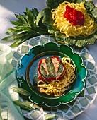 Veal tournedos with sage on tagliolini
