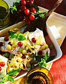 Cod fillet with ribbon noodles and grapes