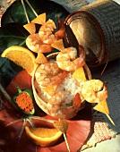Shrimp kebabs with orange pieces