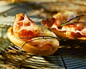 Halved baked potatoes with ham and cheese topping