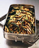 Grilled courgettes with pine nuts