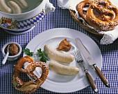 3 white sausages (Weisswurst) with sweet mustard & a pretzel