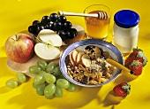 Muesli and ingredients: cereals, fruit, honey, yoghurt