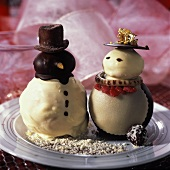 White and dark chocolate snowmen as dessert