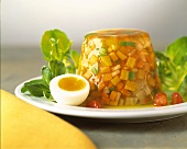 Vegetables in aspic with corn salad and boiled egg