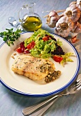 Nile perch fillet with salad leaves