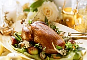 Christmas duck with apples and herbs