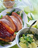 Glazed roast ham with potato salad