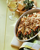Baked crespelle filled with green asparagus