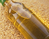 A bottle of sesame oil on sesame seeds