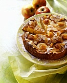 A baked apple cake and apples