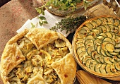 Courgette quiche and artichoke tart