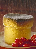 Semolina souffle on plate with fresh redcurrants