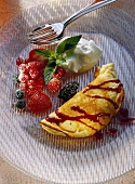 Soufflé omelette with mixed berries