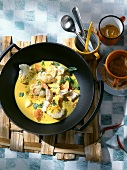 Fish curry with cauliflower in wok