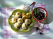 Sweet cream puff filled with cherries