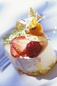 Cream tarts with berries and physalis