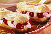 Eclairs filled with sour cherries and cream