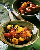Colourful cherry tomato salad with black olives