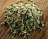 Fennel seed on brown background