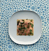 Salmon carpaccio with fresh herbs