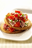Oatcake topped with ham and tomato