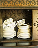 Tableware in cupboard