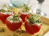 Tomatoes stuffed with cream cheese and garden cress