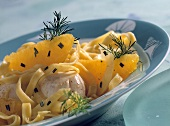 Scallops with tagliatelle on orange and fennel sauce