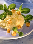 Mashed potato with truffle oil, croutons and corn salad