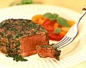 Herb fillet with tomatoes