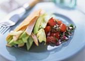Taco shell with turkey breast, avocado and tomato salsa