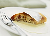 Pear and apple strudel with vanilla sauce
