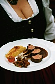 Lamb chop on rosemary jus with potato gratin