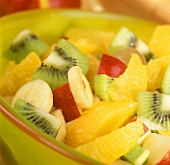 Fruit salad with tropical fruits and apples
