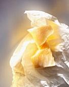 Pieces of parmesan on paper