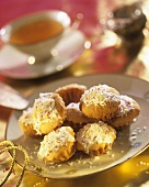 Mini-muffins with glacé icing and grated coconut