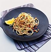 Spaghetti ai pinoli (Spaghetti with toasted pine nuts)