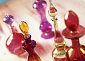 Decorated bottles of perfumed oils