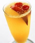 A glass of peach fizz