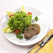 Peppered steak with salad garnish