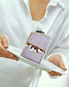 A piece of blueberry cream gateau