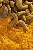Turmeric roots on turmeric powder